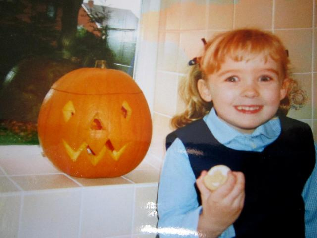Here's a picture of me with my carved pumpkin